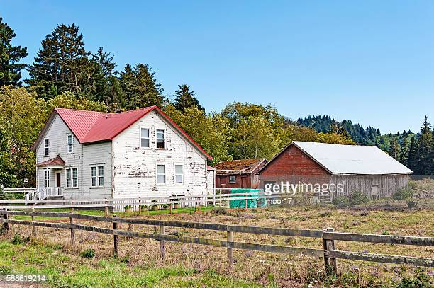 Old Farm House With Barn And Fence