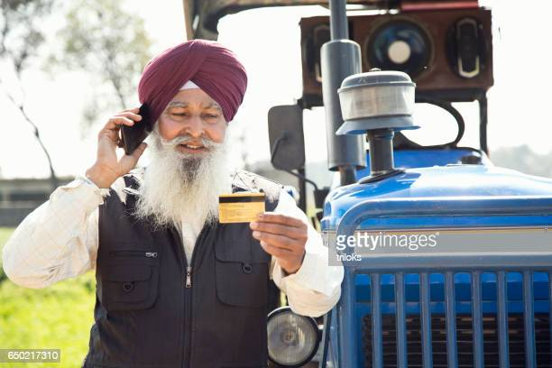 Old farmer calling credit card customer support