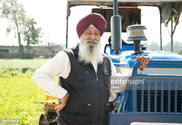 Old farmer with tractor