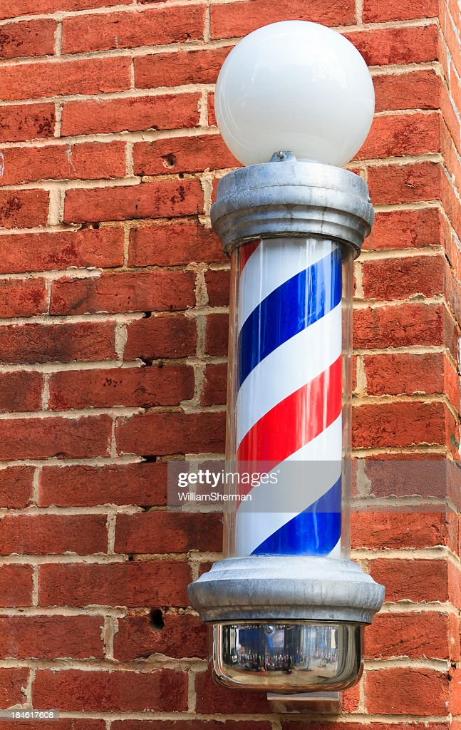 Old Fashioned Barbershop Pole On Brick Wall : Stock Photo