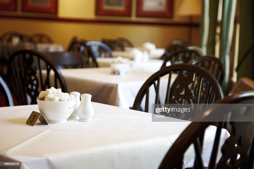 Old fashioned british café tables : Stock Photo