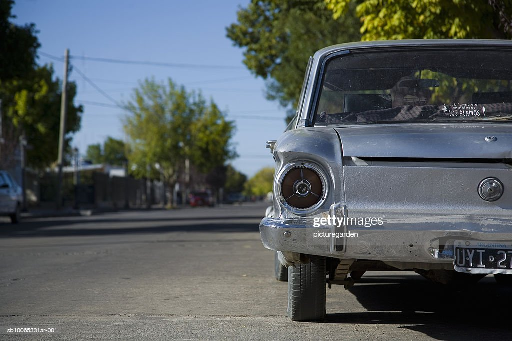 Old fashioned car standing by road : Foto stock