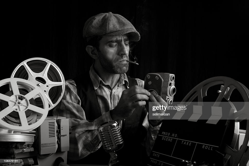 Old Fashioned Cinema Director Posing With Cinema Equipments And Smoking : Stock Photo