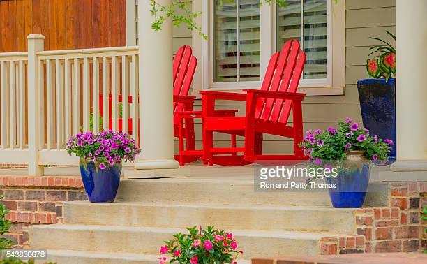 old fashioned home front porch with red rocking chairs (p) - lubbock stock pictures, royalty-free photos & images
