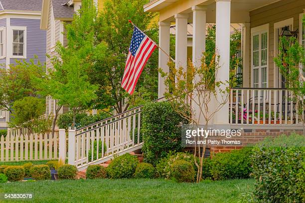 old fashioned home town street with american flag (p) - lubbock stock pictures, royalty-free photos & images