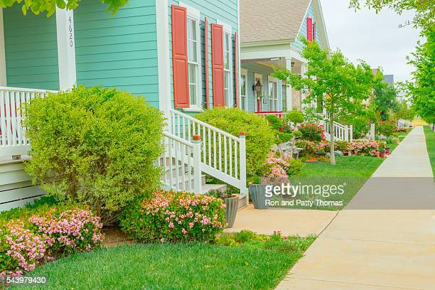 old fashioned home town street with gardens and porches (p) - lubbock stock pictures, royalty-free photos & images