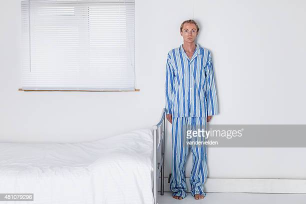 Old Fashioned Man In His Stark Bedroom