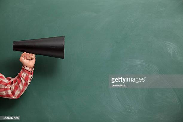 Old Fashioned Megaphone In Human Hand On Green Blank Blackboard