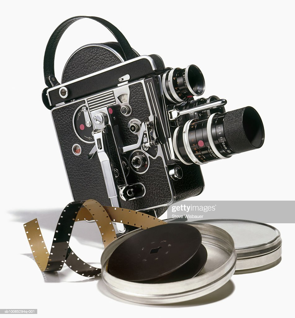 Old fashioned motion picture camera and box with film reel, studio shot : Foto stock