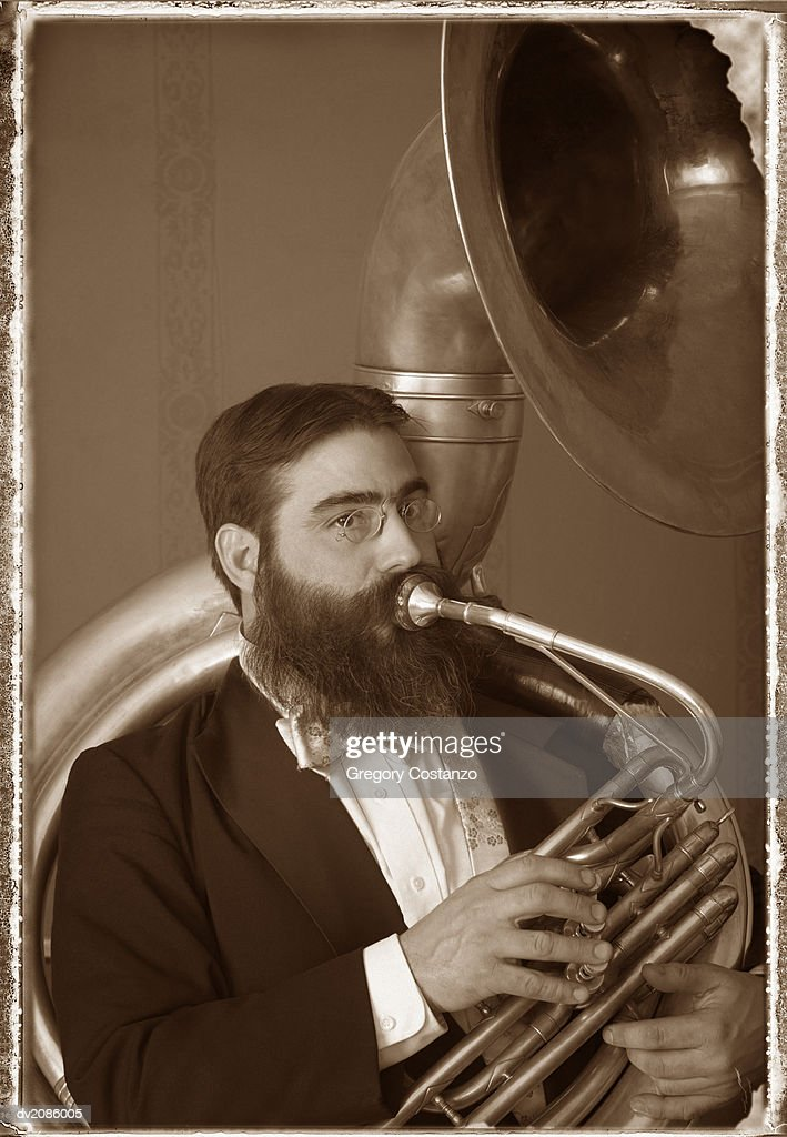 Old Fashioned Portrait of a Male Tuba Player : Stock Photo