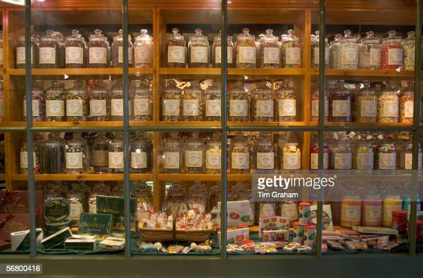 Old fashioned sweet shop with candy in glass jars in Burford Oxfordshire United Kingdom