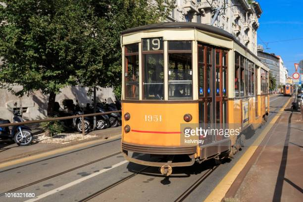 Old fashioned tram or streetcar, driving through Milan, Italy
