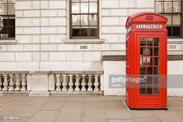 Old fashioned UK red telephone box on Whitehall, London