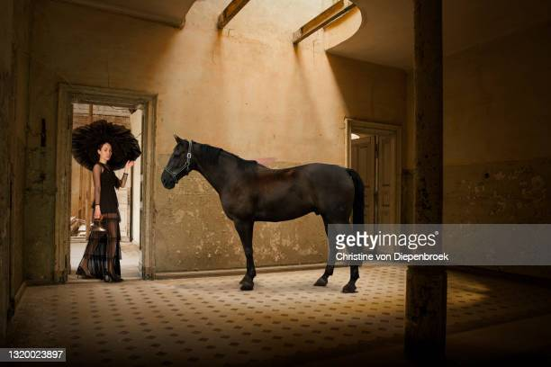 old fashioned woman with horse - extremism stock pictures, royalty-free photos & images