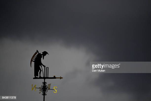 Old Father Time is seen against stormy skies during day one of the 3rd Investec Test Match between England and the West Indies at Lord's Cricket...
