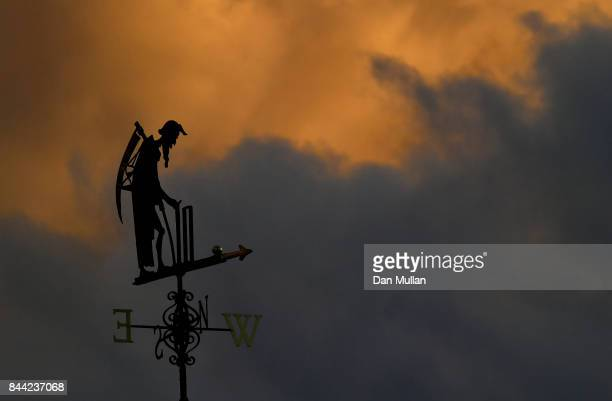 'Old Father Time' the weather vane is seen against stormy skies during day two of the 3rd Investec Test Match between England and the West Indies at...