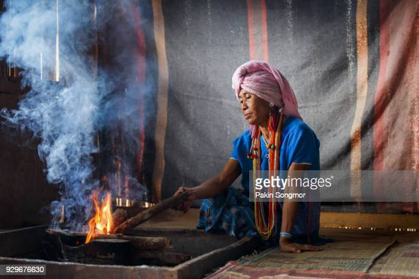Old female karen hill tribe is cooking traditional