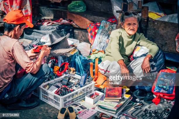 old female street vendor in manila, philippines - old manila stock pictures, royalty-free photos & images