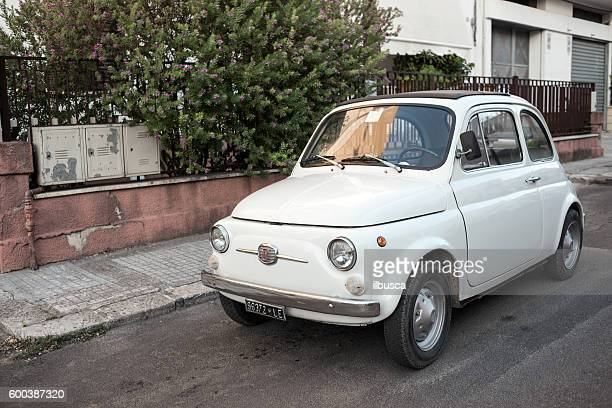 Old Fiat 500 car parked in the street