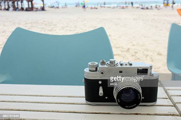 old film camera at the beach - camera point of view stock photos and pictures