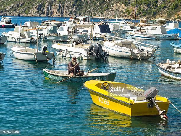 Old fisharman in Komiza port on Adriatic coast in Croatia