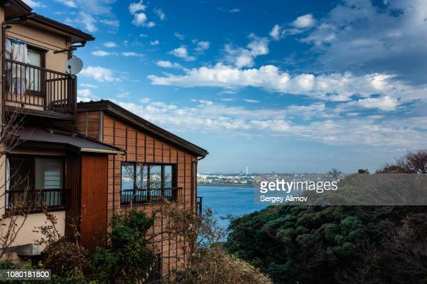 old fisher houses in enoshima, japan - pacific ocean stock pictures, royalty-free photos & images