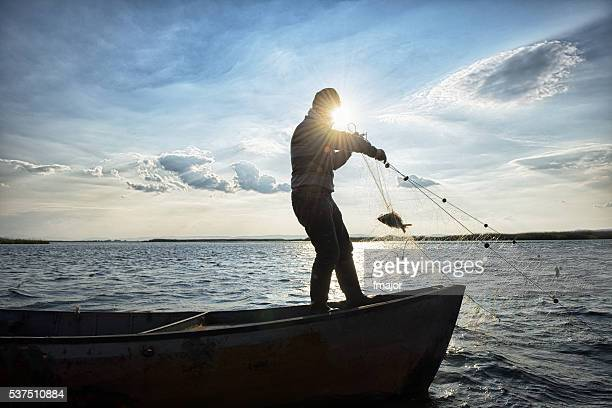 old fisherman on his boat - fishing industry stock pictures, royalty-free photos & images