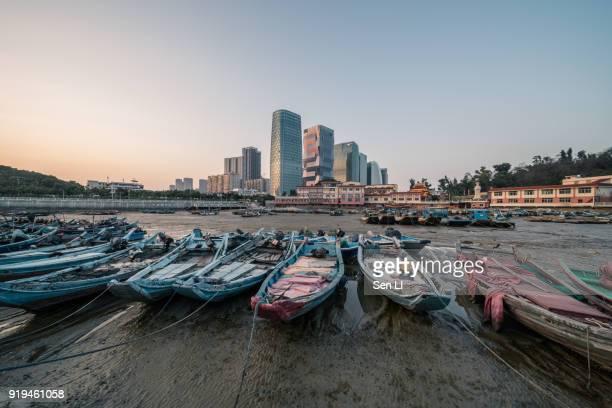 old fishing port and modern city center, xiamen - xiamen fotografías e imágenes de stock