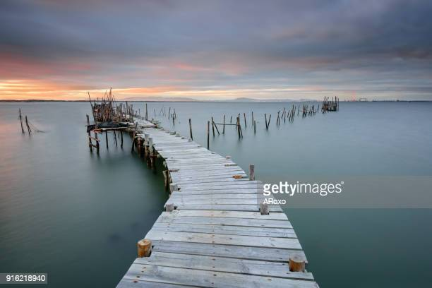 old fishing port of carrasqueira at sunset. alentejo, portugal - comporta portugal stock photos and pictures