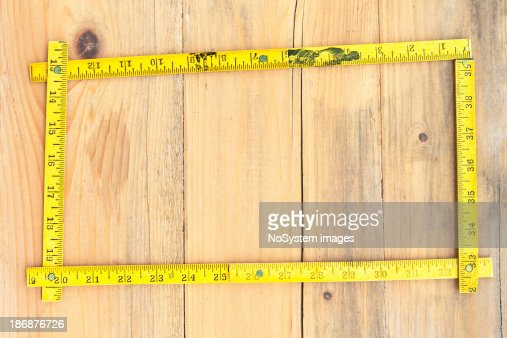 Wandplank 1 Meter.Old Folded Meter In Frame Composition On Plank Wood Stock Photo