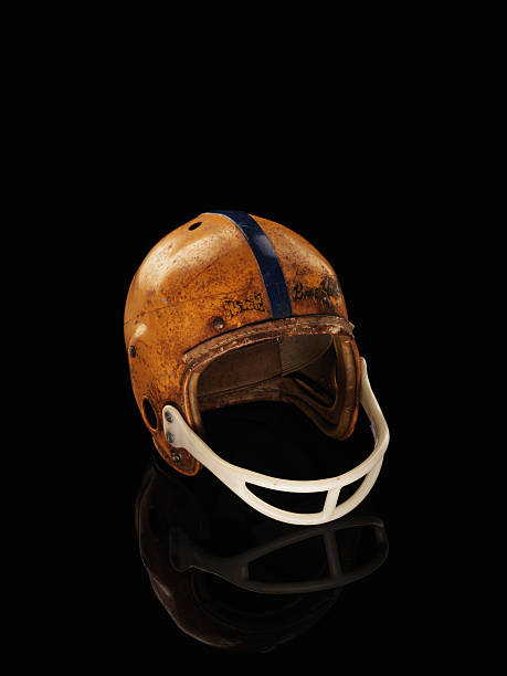 old football helmet on black background