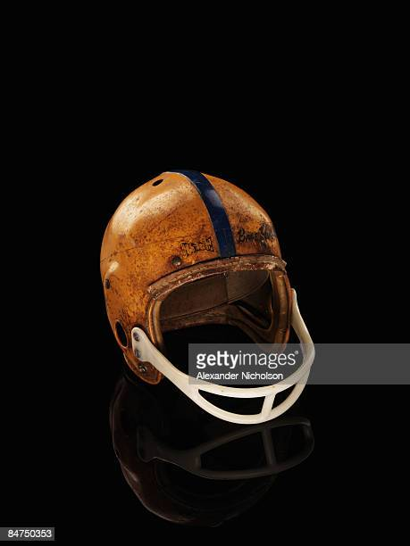 old football helmet on black background - capacete capacete esportivo - fotografias e filmes do acervo