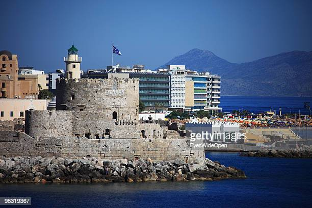 Old Fort tower of Rhodes city and modern hotels at Mandraki harbour on July 16 2009 in Rhodes Greece Rhodes is the largest of the Greek Dodecanes...