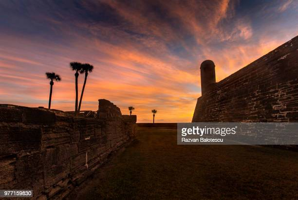 old fortress at sunrise, st augustine, florida, usa - st. augustine florida stock photos and pictures