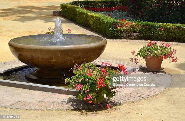 Old fountain in the gardens of the Alcazar of Jerez.The Alcazar of Jerez was built in the twelfth century by the Almohads and is the most iconic...