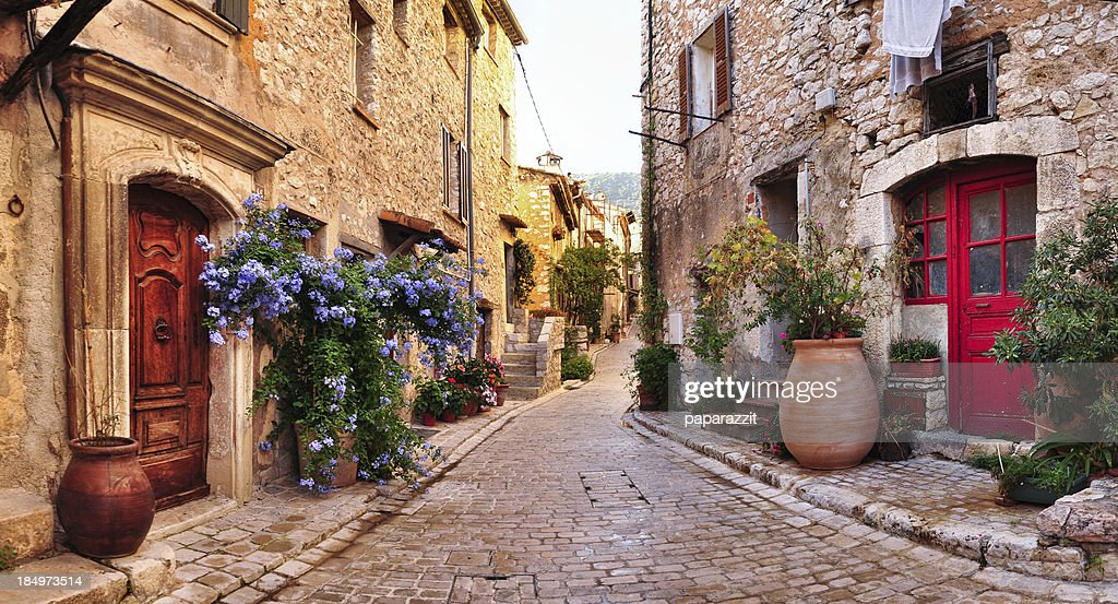 Old French village houses and cobblestone street : Stock Photo