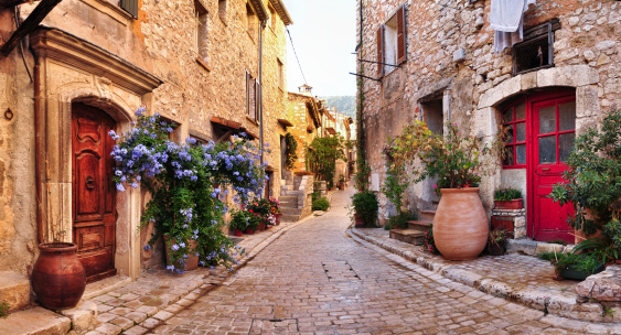 Old French village houses and cobblestone street 184973514