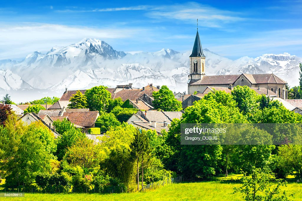 Old French village in countryside with Mont Blanc Alps mountains : Stock Photo