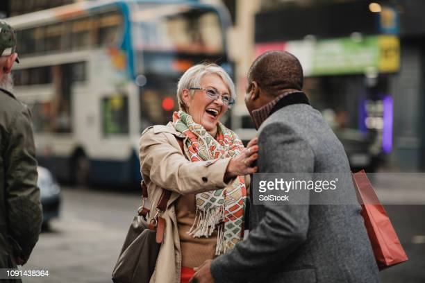 old friends catching up - hello december stock pictures, royalty-free photos & images