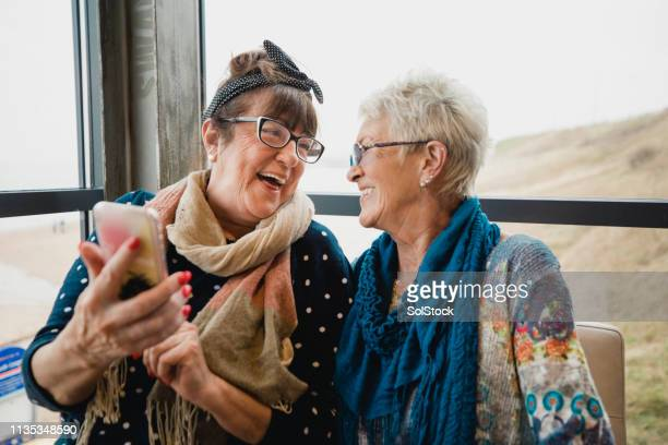 old friends catching up - old lady funny stock pictures, royalty-free photos & images