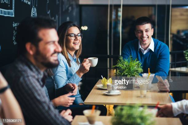 old friends in cafe enjoying in reunion. - casual clothing stock pictures, royalty-free photos & images