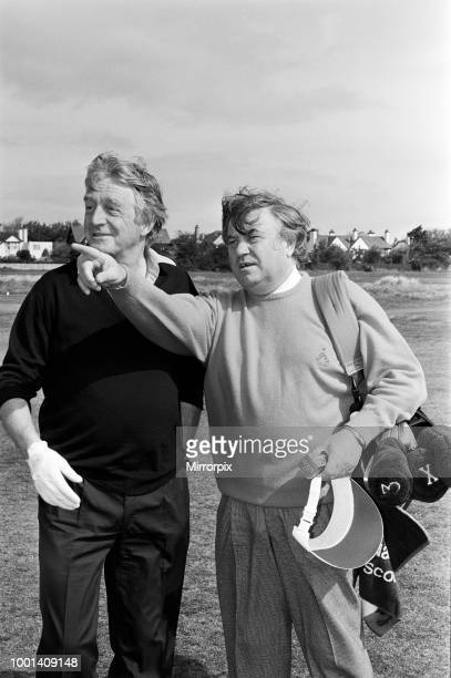Old friends Michael Parkinson and Jimmy Tarbuck on the fairway at The Royal Liverpool Golf Club Wirral for the celebrity tournament in aid of Alder...