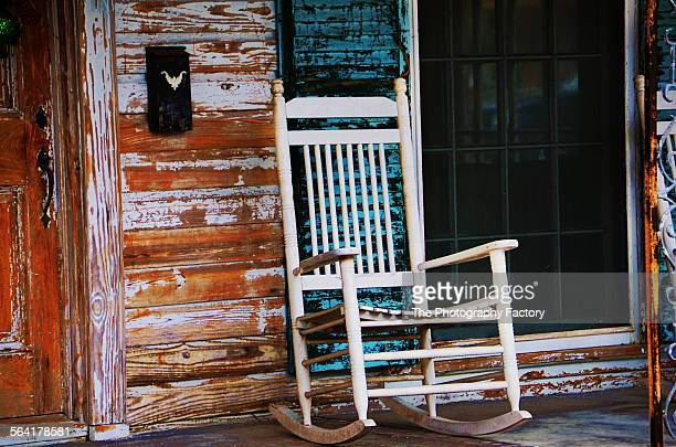 old front porch and rocking chair - southern usa stock pictures, royalty-free photos & images