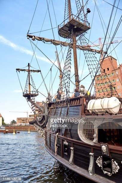 old galleon ship carrying tourists on motlawa river in gdansk - motlawa river stock pictures, royalty-free photos & images