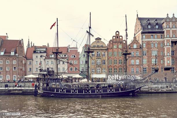 old galleon ship moored at motlawa river in gdansk - motlawa river stock pictures, royalty-free photos & images