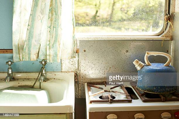 Old gas cooker, sink and kettle