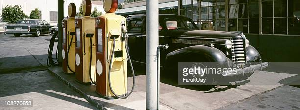 old gas station and vintage car - gas station stock pictures, royalty-free photos & images