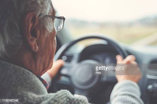 old gentleman drives car - traffic accident stock pictures, royalty-free photos & images