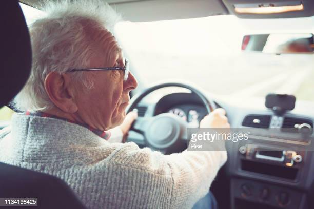 old gentleman drives car - driver stock pictures, royalty-free photos & images