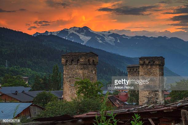 Old Georgian town with towers at sunset. Svaneti